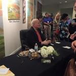 Conroy Pat signing books